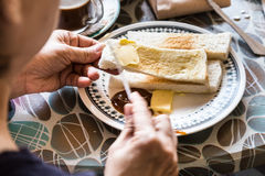 Series of person applying butter and kaya to steamed bread Stock Photography