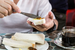 Series of person applying butter and kaya to steamed bread Stock Image