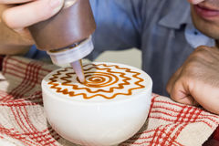 Series of person decorating coffee with art Royalty Free Stock Images