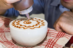 Series of person decorating coffee with art Stock Photos