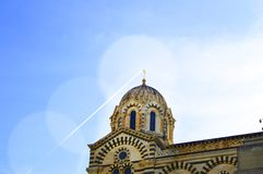 A series of 8 photos - a trace in the sky from the plane flying over Notre Dame de La garde Cathedral in Marseille, the Symbol of. Marseille, step, 2, kit stock image