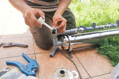 Series of plumber fixing up outdoor water filter with pvc piping Stock Image