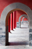 Series of rches. Stone passageway through a series of arches and bright red walls Stock Images