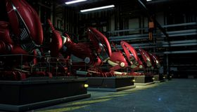 A series row of large red robots in the force of a fallout on pedestals in the shop floor at night. Sci-fi futuristic. Series row of large red robots in the stock illustration