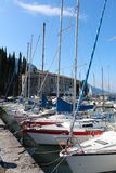Series of sailboats, dock at Lake Garda, Italy Stock Image