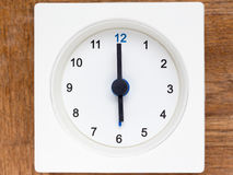 Series of the sequence of time on the simple white analog clock. The series of the sequence of time on the simple white analog clock , 25/48 stock photo