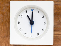 Series of the sequence of time on the simple white analog clock. The series of the sequence of time on the simple white analog clock , 45/48 stock photography
