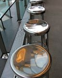 Series of shiny metal counter stools Royalty Free Stock Photo