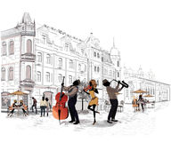 Series of the streets with people in the old city. Street musicians Stock Photography