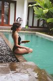 Series traveling girl in Asia. beautiful girl with long dark hair in swimming suit in beautiful nature place in Bali. Series traveling girl in Asia. beautiful in stock photography