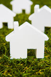 Series Of White Model House Arranged On Grass Royalty Free Stock Images