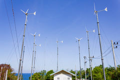 Series of wind power generators in clear blue sky background. Royalty Free Stock Images
