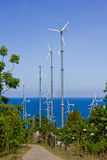 Series of wind power generators in clear blue sky background. Stock Photography