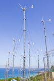 Series of wind power generators in clear blue sky background. Royalty Free Stock Photo