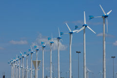 Series of wind power generators in clear blue sky background. Stock Photos