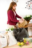 Reusable: Bags Of Groceries Wait on Table to Be Unpacked. Series with a woman unpacking groceries and using reusable fabric bags Stock Photo
