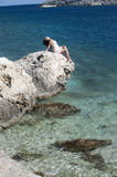 Series of a women on a rock. Series of a beautiful woman on a rock in the sea Royalty Free Stock Image