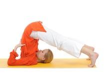 Series or yoga photos.woman in halasana pose Royalty Free Stock Photography