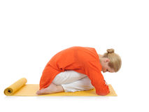 Series or yoga photos.young woman in virasana pose Stock Photography