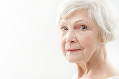 Serine senior lady with wrinkles on face Stock Photography