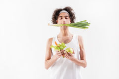 Serine slim young man with healthy food Stock Photos