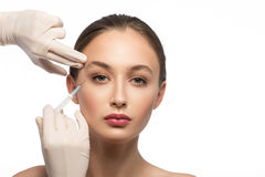 Serine woman receiving botox injection Royalty Free Stock Photo