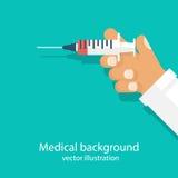 Seringa na mão do doutor Imagem de Stock