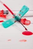 Seringas e IV linhas cobertas com o sangue Imagem de Stock Royalty Free