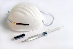 Seringue de masque chirurgical photos stock