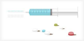 Seringue et tablettes A Image stock