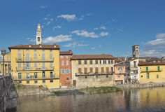 Serio river in Seriate  with bright colored houses on its bank, Lombardy, Italy Royalty Free Stock Photo