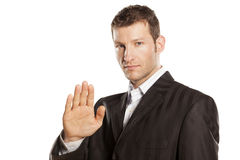 Serio stop placed hands. Serious businessman with stop placed hand on white backgroundus royalty free stock images