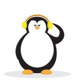 Serios penguin cartoon with headphone. Stock Photos
