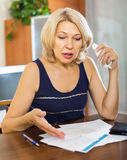 Serios woman filling financial documents Royalty Free Stock Images