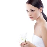 Serioulsy woman holding lily flower Royalty Free Stock Image
