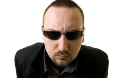 Serious. Man with spectacles on a white background Stock Image