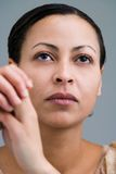 Serious. Portrait of an serious looking mulatto woman Stock Photos