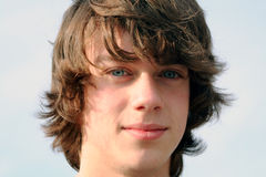 So Serious. Closeup portrait of teenage boy with serious expression royalty free stock images
