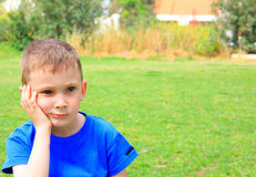 Serious. Little boy thinking about something Royalty Free Stock Images