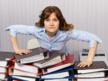 Serious accountant at workplace with documents stock photos