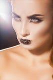 Serious adult woman looking away with beautiful makeup Stock Images