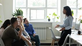 Free Serious African American Female Leader, Mentor Holding Briefing For Team. Royalty Free Stock Photography - 181554117