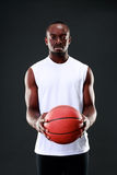 Serious african american holding  basketball ball Royalty Free Stock Images