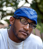 Serious African American man. Posing African American man with bandana royalty free stock image