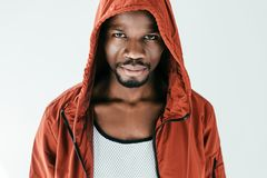 Serious african american man in orange hood. Isolated on white royalty free stock images