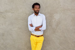 Serious african american man in yellow trousers staring. Portrait of serious african american man in yellow trousers staring Royalty Free Stock Images