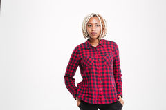 Serious african american woman with braids in checkered shirt Royalty Free Stock Images