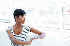 Serious african american young woman accountant in office Stock Photos