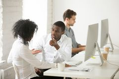 Serious african american colleagues talking discussing project t royalty free stock images