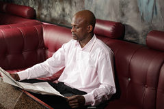 Serious african man reading paper Stock Photography
